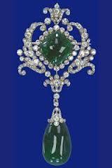 Scroll Cambridge Emerald Brooch - blue background