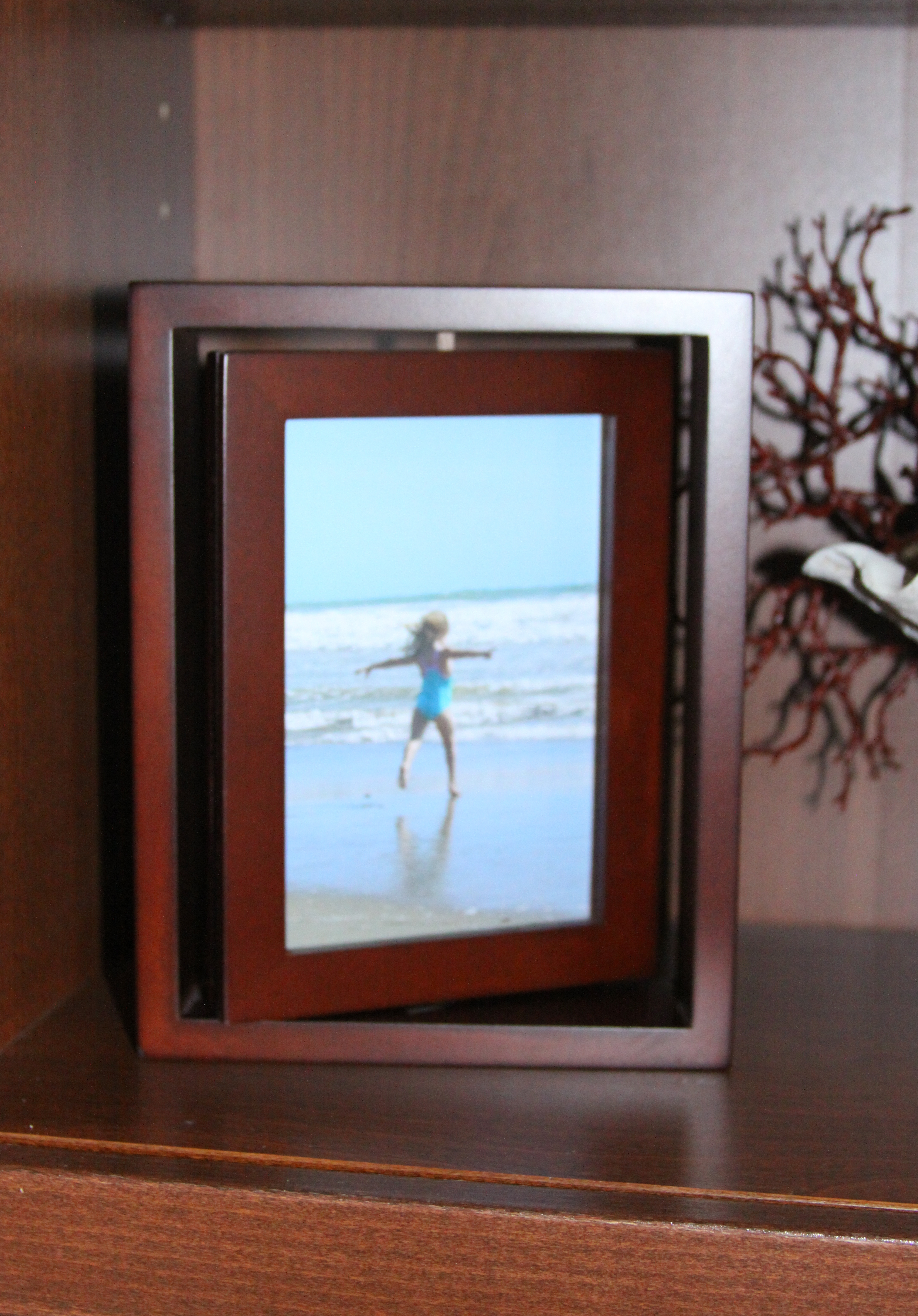 Beach memorabilia display the enchanted manor beach book shelf rotating frame 2 jeuxipadfo Gallery
